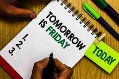 Handwriting text Tomorrow Is Friday. Concept meaning Weekend Happy holiday taking rest Vacation New week Diary pen notepad ring pe. N marker pointer script daily royalty free stock image