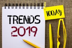 Handwriting text Trends 2019. Concept meaning Current Movement Latest Branding New Concept Prediction written on Notebook Book on. Handwriting text Trends 2019 stock photos