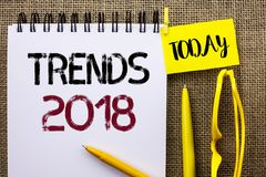 Handwriting text Trends 2018. Concept meaning Current Movement Latest Modern Branding New Concept Prediction written on Notebook B. Handwriting text Trends 2018 royalty free stock photography