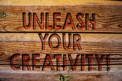 Handwriting text Unleash Your Creativity Call. Concept meaning Develop Personal Intelligence Wittiness Wisdom Wooden background vi. Ntage wood board wild message stock images