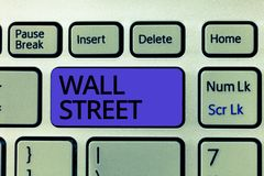 Handwriting text Wall Street. Concept meaning Home of the New York Stock Exchange Brokerages headquarters stock photos