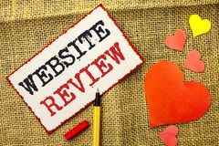 Handwriting text Website Review. Concept meaning Homepage Evaluation Customer Opinion Satisfaction Ranking written on Sticky Note. Handwriting text Website royalty free stock photo