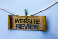 Handwriting text Website Review. Concept meaning Homepage Evaluation Customer Opinion Satisfaction Ranking written on Cardboard Pa. Handwriting text Website stock photos