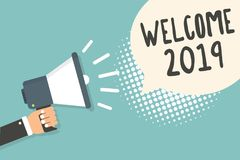 Handwriting text Welcome 2019. Concept meaning New Year Celebration Motivation to Start Cheers Congratulations Man holding megapho. Ne loudspeaker speech bubble royalty free illustration