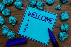 Handwriting text Welcome. Concept meaning Warm salutation acknowledgement for someone amiable loved thanked Cyan paper imagination. Idea thoughts mistakes stock photos