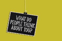 Handwriting text What Do People Think About You question. Concept meaning Opinion of others Considerations Hanging blackboard mess