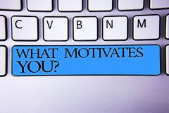 Handwriting text What Motivates You Question. Concept meaning Passion Drive Incentive Dream Aspiration Alphabetic buttons blue spa. Cebar elementary part of royalty free stock photo