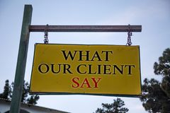 Handwriting text What Our Client Say. Concept meaning Customers Feedback or opinion about product service Messages object location. Yellow banner frame metal Royalty Free Stock Images