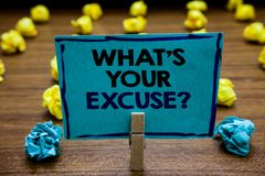 Handwriting text What s is Your Excuse question. Concept meaning Explanations for not doing something Inquiry Blurry wooden deck y. Ellow and blue lob on ground royalty free stock photography