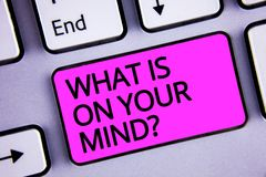 Handwriting text What Is On Your Mind Question. Concept meaning Open minded thinks of intellectual innovation Keyboard purple key. Intention create text Royalty Free Stock Images