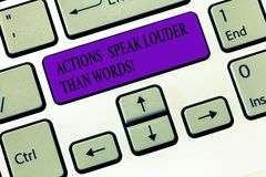 Handwriting text writing Actions Speak Louder Than Words. Concept meaning Make execute accomplish more talk less. Keyboard key Intention to create computer stock image