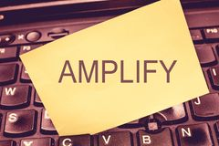 Handwriting text writing Amplify. Concept meaning Make something bigger louder increase the volume using amplifier.  stock photos