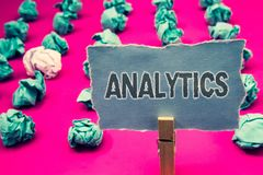 Handwriting text writing Analytics. Concept meaning Data Analysis Financial Information Statistics Report Dashboard Clothespin hol. Ding green paper crumpled stock image