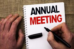 Handwriting text writing Annual Meeting. Concept meaning Yearly Company Assembly Business Conference Report Event written by Man H. Olding Marker Notebook Book stock photos