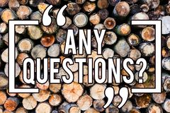 Handwriting text writing Any Questionsquestion. Concept meaning Need to ask something Extra Information Wanted Wooden background. Vintage wood wild message royalty free stock photos