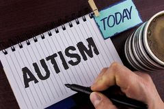 Handwriting text writing Autism. Concept meaning Autism Awareness conducted by social committee around the globe written by Man on. Handwriting text writing Stock Photo