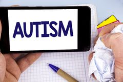 Handwriting text writing Autism. Concept meaning Autism Awareness conducted by social committee around the globe written on Mobile. Handwriting text writing Royalty Free Stock Photography