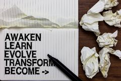 Handwriting text writing Awaken Learn Evolve Transform Become . Concept meaning Inspiration Motivation Improve Marker over noteboo. K crumpled papers ripped stock photos