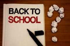 Handwriting text writing Back To School. Concept meaning Return to class first day of studies Classroom Arriving Text notebook bla. Ck marker open desk question stock photos