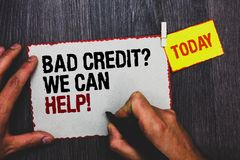 Handwriting text writing Bad Credit question We Can Help. Concept meaning Borrower with high risk Debts Financial Hand grip black. Marker writing text paperclip royalty free stock photography