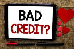 Handwriting text writing Bad Credit Question. Concept meaning Low Credit Finance Economic Budget Asking Questionaire written on Ta. Handwriting text writing Bad stock images