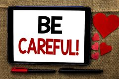 Handwriting text writing Be Careful. Concept meaning Caution Warning Attention Notice Care Beware Safety Security written on Table royalty free stock photography