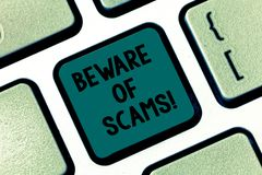 Handwriting text writing Beware Of Scams. Concept meaning Stay alert to avoid fraud caution be always safe security. Keyboard key Intention to create computer stock photos