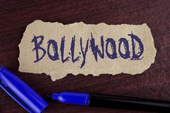 Handwriting text writing Bollywood. Concept meaning Indian cinema a source of entertainment written on Tear Cardboard paper piece. Handwriting text writing Royalty Free Stock Images