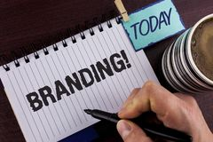 Handwriting text writing Branding Motivational Call. Concept meaning Creating a unique identity for new startup agencies written b. Y Man Notepad holding Marker Stock Image