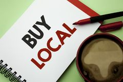 Handwriting text writing Buy Local. Concept meaning Buying Purchase Locally Shop Store Market Buylocal Retailers written on Notebo. Handwriting text writing Buy Stock Image