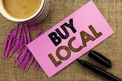 Handwriting text writing Buy Local. Concept meaning Buying Purchase Locally Shop Store Market Buylocal Retailers written on Pink S. Handwriting text writing Buy Royalty Free Stock Photo