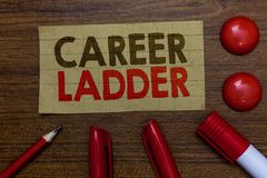 Handwriting text writing Career Ladder. Concept meaning Job Promotion Professional Progress Upward Mobility Achiever. Paperboard markers pencil wooden stock images