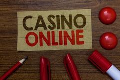 Handwriting text writing Casino Online. Concept meaning Computer Poker Game Gamble Royal Bet Lotto High Stakes Paperboard markers royalty free stock photos