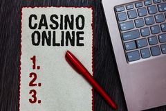Handwriting text writing Casino Online. Concept meaning Computer Poker Game Gamble Royal Bet Lotto High Stakes Piece paper red bor royalty free stock photography
