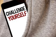 Handwriting text writing Challenge Yourself. Concept meaning Overcome Confidence Strong Encouragement Improvement Dare Hoar frost. Color side pocket cell phone Stock Image