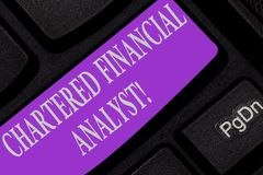 Handwriting text writing Chartered Financial Analyst. Concept meaning Investment and financial professionals Keyboard. Key Intention to create computer message stock image