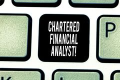 Handwriting text writing Chartered Financial Analyst. Concept meaning Investment and financial professionals Keyboard. Key Intention to create computer message stock photo