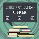 Handwriting text writing Chief Operating Officer. Concept meaning responsible for the daily operation of the company. Uneven Pile of Hardbound Books and Blank royalty free illustration