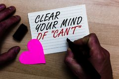 Handwriting text writing Clear Your Mind Of Can t not. Concept meaning Have a positive attitude thinking motivation Written on not. Epad hand hold marker with Royalty Free Stock Photos