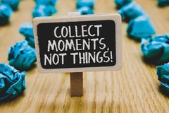 Handwriting text writing Collect Moments, Not Things. Concept meaning Happiness philosophy enjoy simple life facts Stand blackboar. D with white words behind royalty free stock images