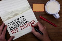 Handwriting text writing Collect Moments, Not Things. Concept meaning Happiness philosophy enjoy simple life facts Sticky note red. Pen coffee with coffee mug royalty free stock photos