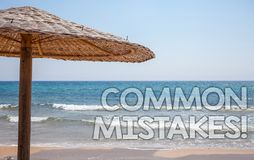 Handwriting text writing Common Mistakes Motivational Call. Concept meaning lot of people do same action in wrong way Blue beach w. Ater Thatched Straw Umbrellas Stock Image