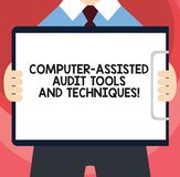 Handwriting text writing Computer Assisted Audit Tools And Techniques. Concept meaning Modern auditing applications Man in Suit. Standing Holding Horizontally royalty free illustration