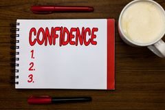 Handwriting text writing Confidence. Concept meaning Have faith in Rely on someone or something Telling secrets Open. Notebook markers inspiration communicate stock photo
