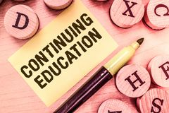Handwriting text writing Continuing Education. Concept meaning Continued Learning Activity professionals engage in stock image