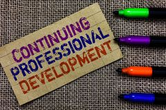 Handwriting text writing Continuing Professional Development. Concept meaning tracking and documenting knowledge. Paperboard computer mouse jute background stock photo
