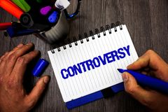 Handwriting text writing Controversy. Concept meaning Disagreement or Argument about something important to people Man hold holdin. G marker notebook ideas Stock Images