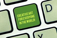 Handwriting text writing Creative Art For Everyone In The World. Concept meaning Spread creativity to others Keyboard. Key Intention to create computer message stock images
