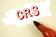 Handwriting text writing Crs. Concept meaning Common reporting standard for sharing tax financial information written on Painted b. Handwriting text writing Crs Royalty Free Stock Photography