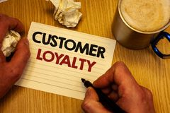 Handwriting text writing Customer Loyalty. Concept meaning Client Satisfaction Long-Term relation Confidence Man holding pen ideas. Notebook crumpled papers royalty free stock photography